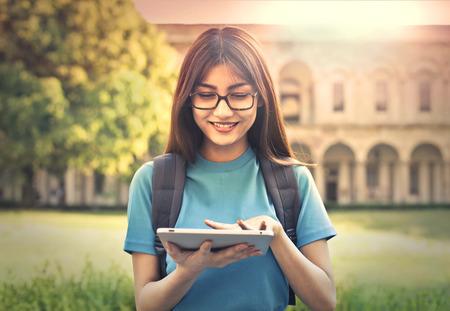 Photo pour Young student using a tablet - image libre de droit