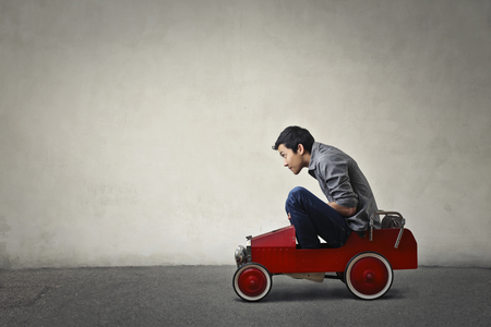 Photo for Sitting in a toy car - Royalty Free Image