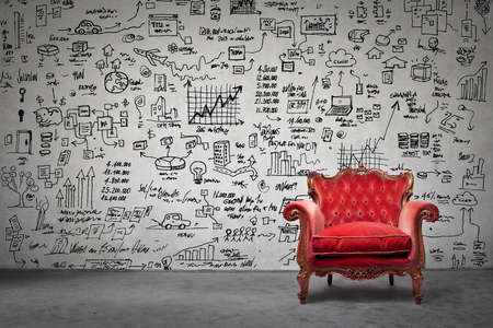 Foto de The red armchair and a lot of drawing on the wall - Imagen libre de derechos