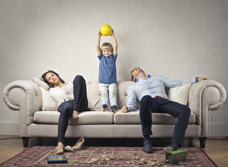 Photo pour Their tired parents with happy child - image libre de droit