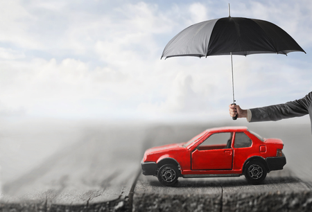 Photo pour Man is Protecting your car from the rain - image libre de droit