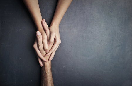Photo for two hands holding a hand - Royalty Free Image