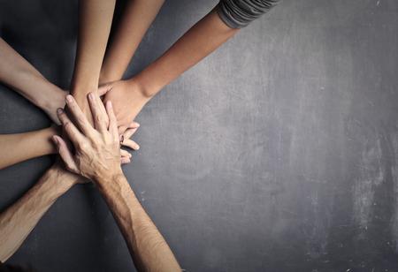 Photo pour Hands on top of each other - image libre de droit