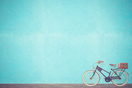 Photo for retro vintage bicycle old and blue wall background design - Royalty Free Image