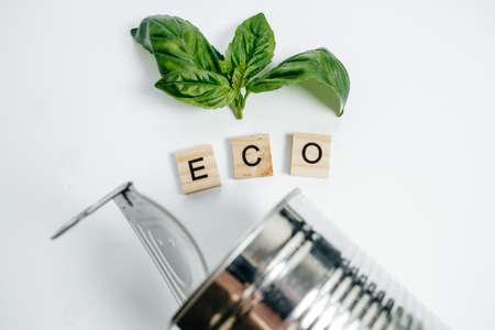 Foto de Aluminum tin and green leaf on the White Background. Eco Concept, Top View - Imagen libre de derechos