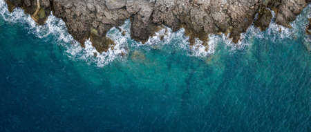 Foto de Aerial view of sea waves and fantastic Rocky coast, Montenegro  - Imagen libre de derechos