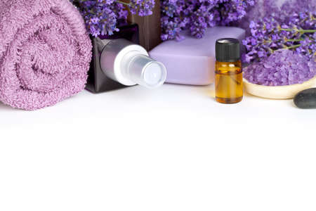Foto de Lavender spa with flowers, oil, salt - beauty composition on white background with copy space - Imagen libre de derechos