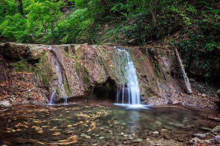 Photo for Kaverzinsky small waterfall in the Caucasus mountains. Russia, Krasnodar region - Royalty Free Image
