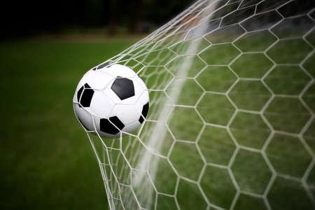 Photo pour soccer ball in goal - image libre de droit