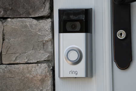 Foto de New York, USA - Circa 2018: Ring video doorbell owned by Amazon. manufactures home smart security products allowing homeowners to monitor remotely via smart cell phone app. Illustrative editorial - Imagen libre de derechos