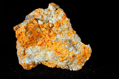 Photo for sulphide mineral realgar on the black  background - Royalty Free Image