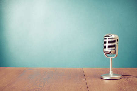 Photo for Retro microphone on table in front aquamarine wall background - Royalty Free Image