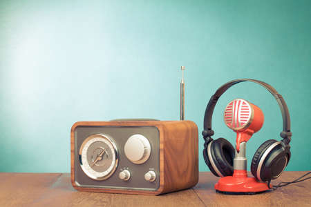 Photo for Retro radio, red microphone, headphones on table old style photo - Royalty Free Image