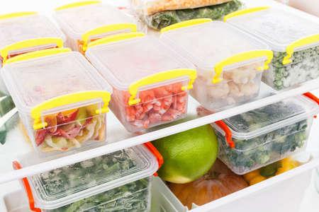 Foto de Frozen food in the refrigerator. Vegetables on the freezer shelves. Stocks of meal for the winter. - Imagen libre de derechos