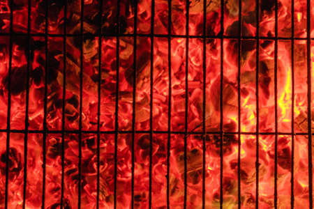Photo for Burning and glowing charcoal with open hot flame and smoke close up - Royalty Free Image