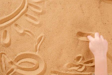 Foto de Sand art therapy, child's hands are painted on a table with sand - Imagen libre de derechos