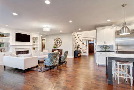 Beautiful living room in luxury home with view of kitchen and entry