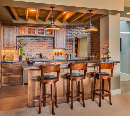 Photo for Bar complete with charis, wine glasses, beer, and new cabinets - Royalty Free Image