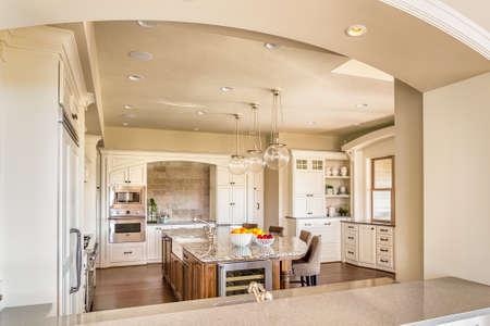 Photo pour Kitchen with Island, Sink, Cabinetrs, and Hardwood Floors - image libre de droit