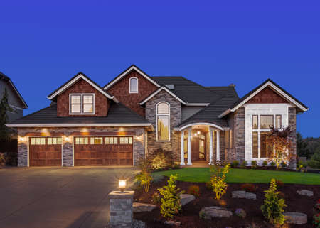 Photo for Front exterior of luxury home in evening - Royalty Free Image