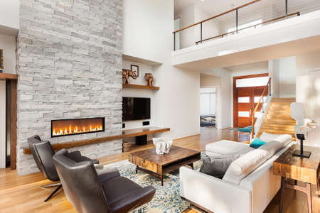 Beautiful living room with hardwood floors and fireplace in new luxury home