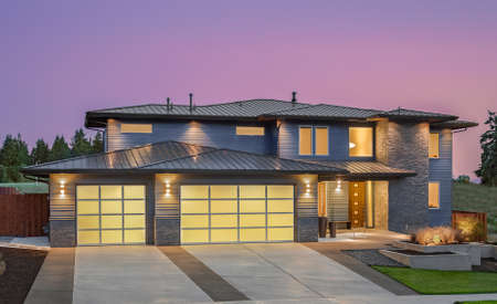 Photo for Beautiful Exterior of New Luxury Home at Sunset - Royalty Free Image