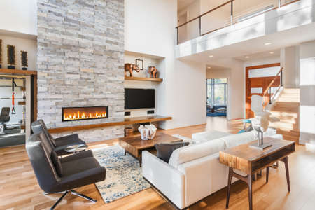 Photo pour Beautiful living room with hardwood floors and fireplace in new luxury home - image libre de droit