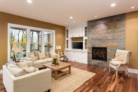 Foto de Beautiful living room interior with hardwood floors and fireplace in new luxury home - Imagen libre de derechos