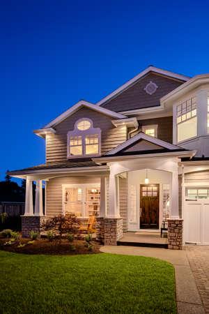 Foto de New Luxury Home Exterior at Night, Vertical Orientation - Imagen libre de derechos