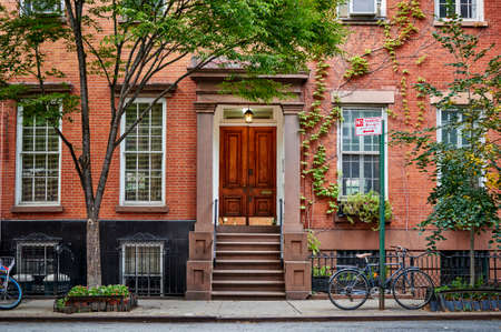 Photo for The front of an ornate brownstone building. - Royalty Free Image