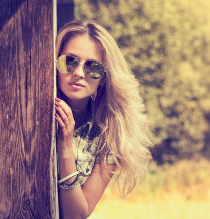 Foto de Trendy Hipster Girl in Sunglasses  Summer Modern Youth Lifestyle  Toned Photo  - Imagen libre de derechos