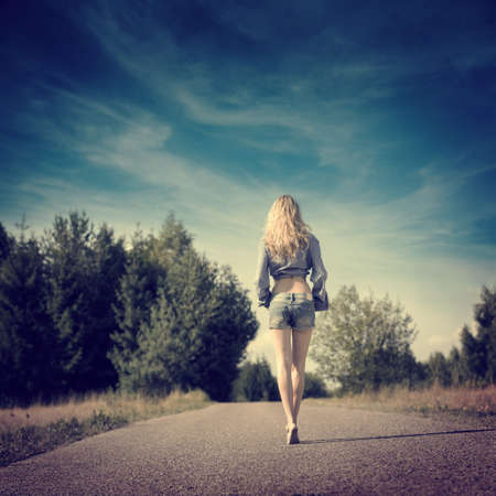 Photo for Full Length Photo of Sexy Blonde Girl Walking Away. - Royalty Free Image