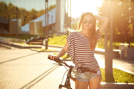 Photo pour Fashion Hipster Teenager with Bicycle in the City. Toned and Filtered Photo. Modern Teenager Lifestyle Concept. - image libre de droit
