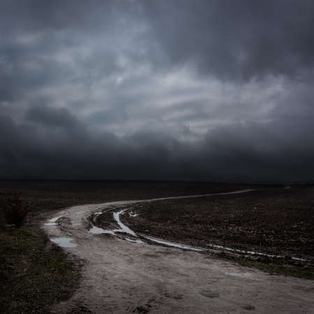 Photo for Night Landscape with Country Road and Dark Clouds. Moody Sky . - Royalty Free Image