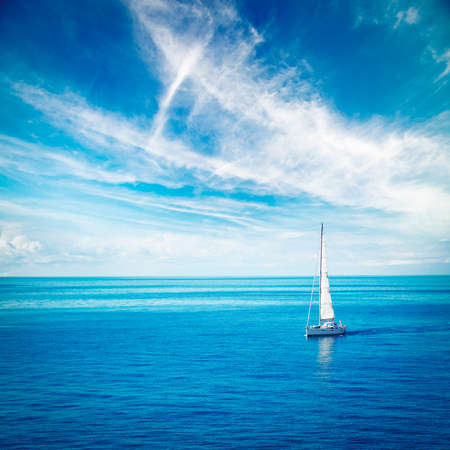 Foto de Beautiful Seascape with White Yacht Sailing in Blue Sea. Square Photo with Copy Space. - Imagen libre de derechos