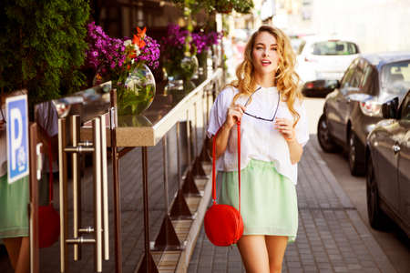 Photo pour Beautiful Fashion Woman in the City Street. Trendy Girl in Summer. Toned Photo. - image libre de droit