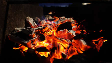 Photo for Embers fire fireplace grill fire flame, black background - bright photo - Royalty Free Image