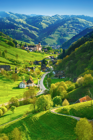 Foto de Beautiful summer landscape: green mountain valley with picturesque countryside and old church. Germany, Black forest. Colorful summer background. - Imagen libre de derechos