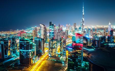Foto de Fantastic nightime skyline of a big modern city. Downtown Dubai, United Arab Emirates. Colorful cityscape with skyscrapers. - Imagen libre de derechos