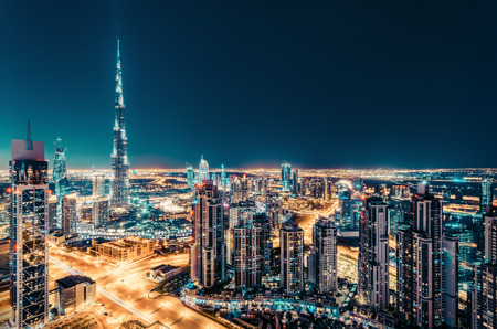 Photo pour Fantastic nighttime skyline of Dubai with illuminated skyscrapers. Rooftop perspective of downtown Dubai, UAE. - image libre de droit