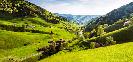 Photo for Scenic panorama view of a picturesque mountain village in Germany, Muenstertal, Black Forest. - Royalty Free Image