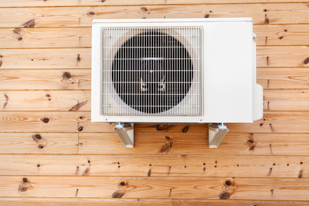 Photo for Exterior airconditioning unit on a wooden wall - Royalty Free Image