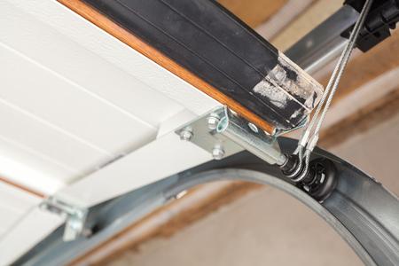 Photo pour Garage doors installation. Close up of lifting system in metal profil - image libre de droit