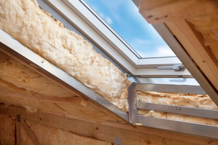 Photo for Plastic (mansard) or skylight window on attic with environmentally friendly and energy efficient thermal insulation rockwool. - Royalty Free Image
