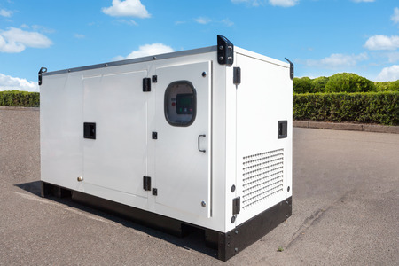 Photo pour Industrial Diesel Generator. Standby generator. Industrial Diesel Generator for Office Building connected to the Control Panel with Cable Wire. Backup Generator Power. - image libre de droit