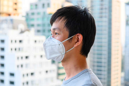 Photo for Asian man wear mask for air pollution - Royalty Free Image