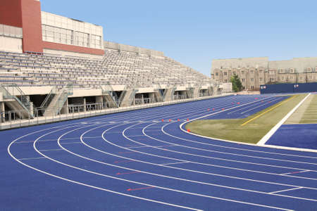 Picture of a track and field stadium with empty stands
