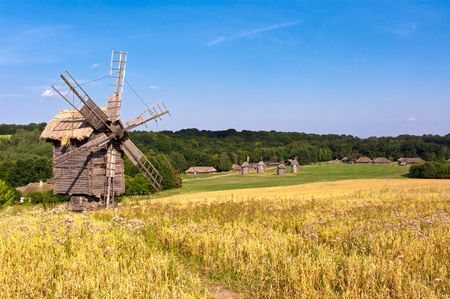 Photo pour Old wooden windmill in the countryside - image libre de droit