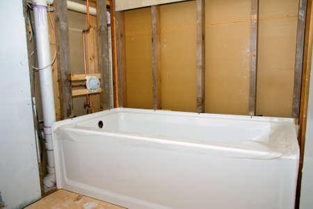 Foto de A new bathtub ready to be installed for a bathroom remodeling project. - Imagen libre de derechos