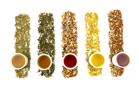 Photo for Tea cups with various colorful teas isolated on white background - Royalty Free Image